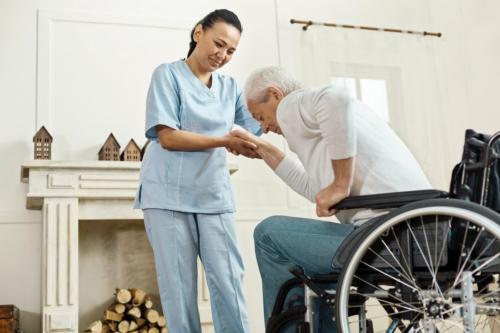 caregiver assisting a senior